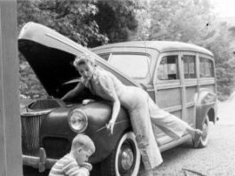 "word Super Deluxe ""Woodie"" station wagon, first introduced late 1940. Women & boy making repairs"